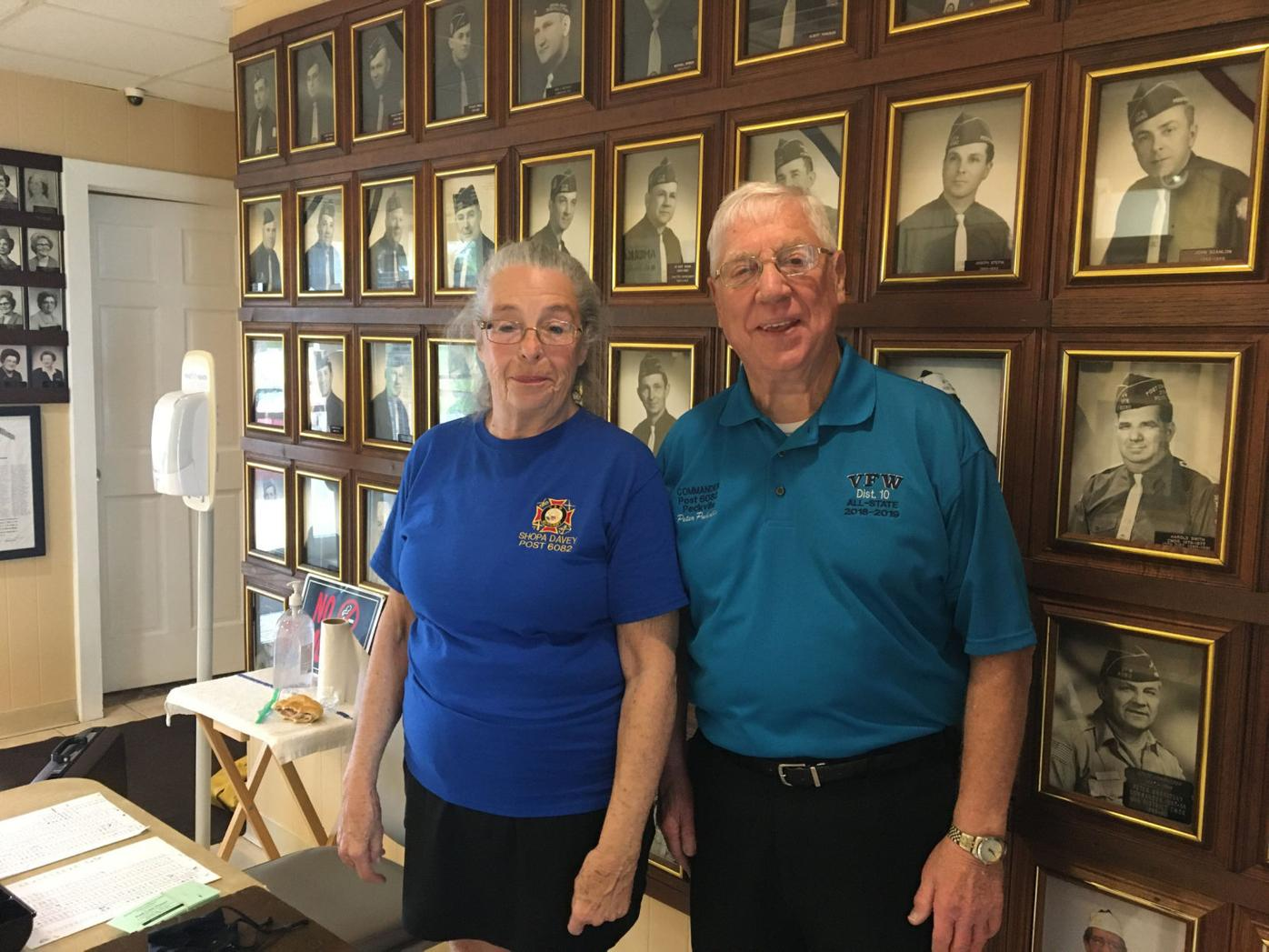 At the VFW Post 6082, Linda Gibney, Trustee of the Auxiliary and VFW Poat Commander Peter Puhulla collect tickets in the lobby