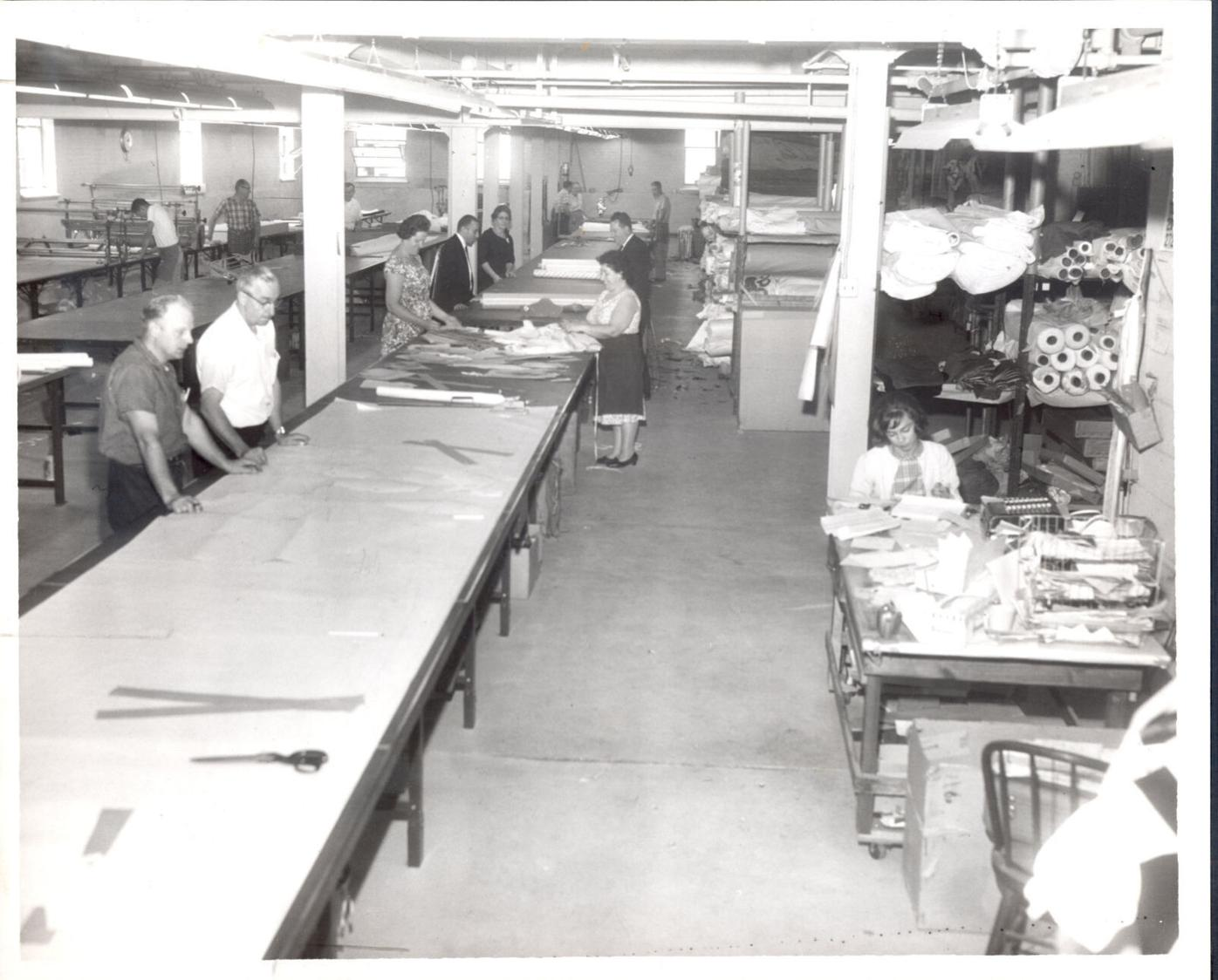 First phase of a two-part expansion program at the Archbald Sewing Co, 142 Cherry St., Archbald, has included renovation of the basement, where the cutting room shown here has been installed, along with offices and a cafeteria. TIMES FILE