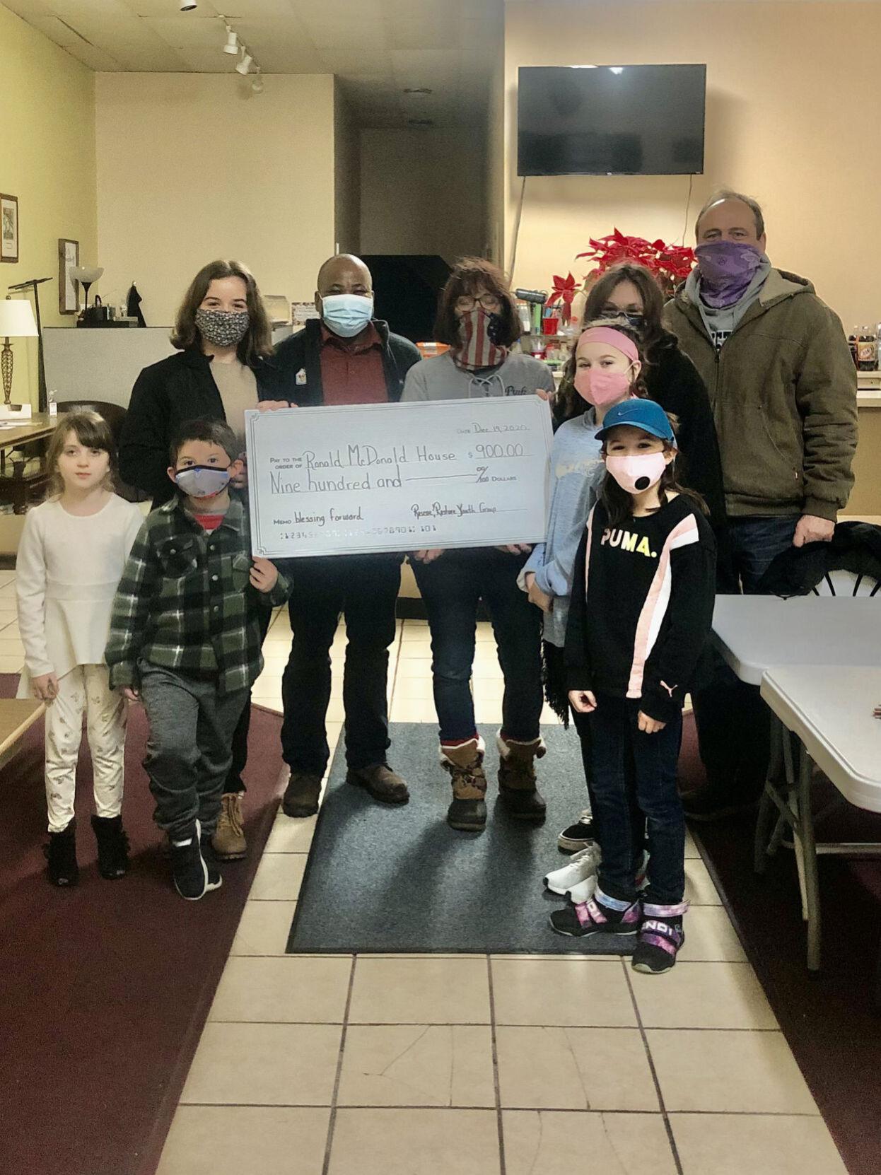 Youth group donates to Ronald McDonald House
