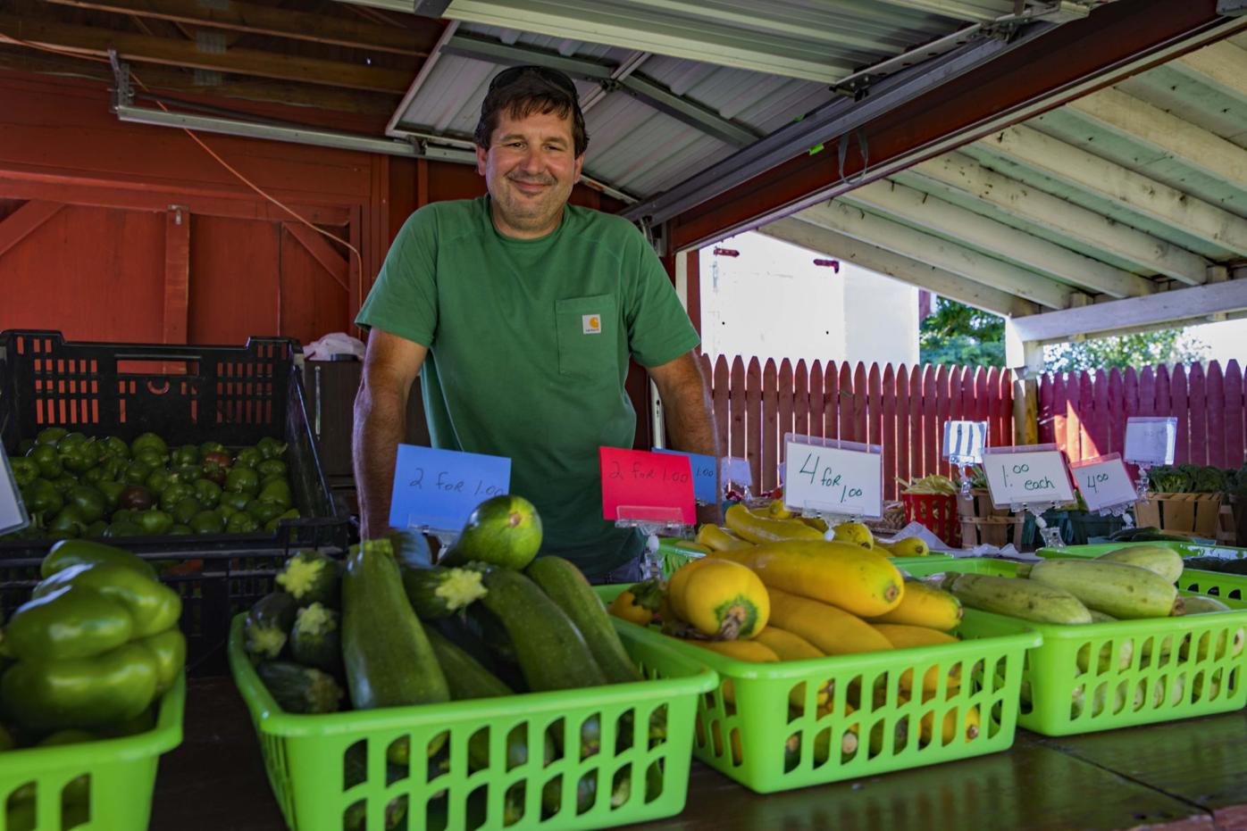 Bill Hopkins, owner of Hopkins behind the counter of his farm stand in Dickson City.