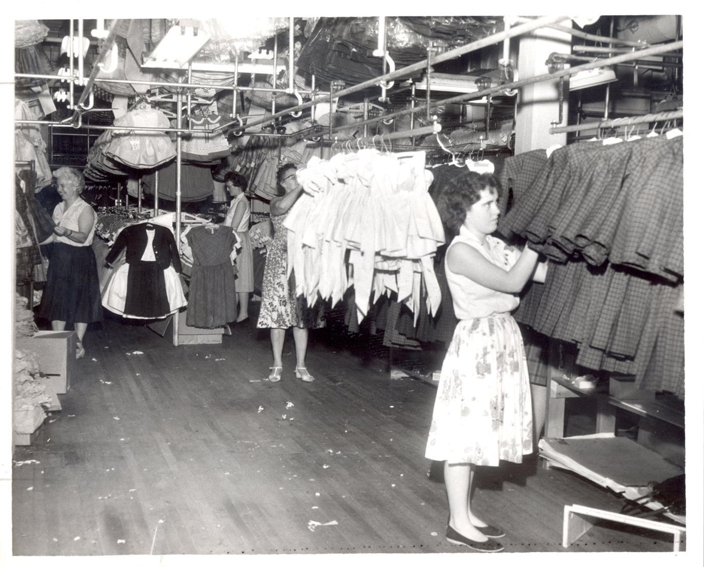 Inspection department on the first floor where girls' dresses are given final approval before shipment. By Sept. 5, 1961, the firm was expected to enlarge their payroll to 205 people. TIMES FILE