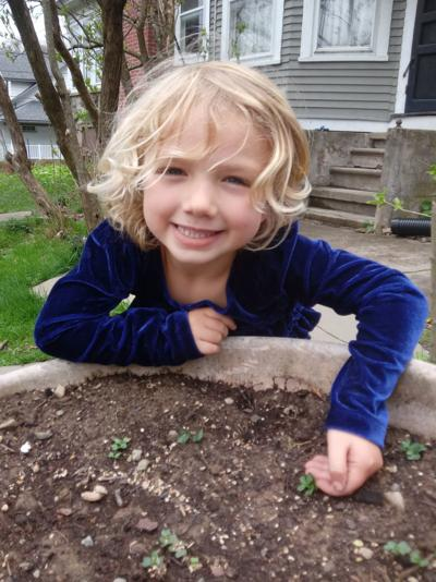 Annaliese Arp with this year's container-grown kale sprouts. SUBMITTED PHOTO