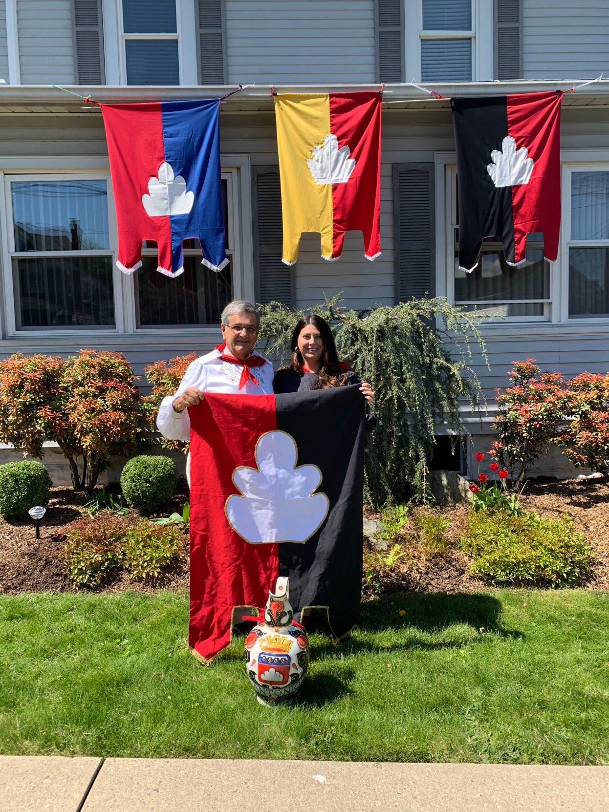 Albert Alunni of Jessup and Victoria Hanson of Dalton Hanson's St. Antonio flag from Gubbio, Italy.