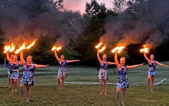 Students at Double R Twirlettes practice their fire baton routine for their pre-recorded performance at the Circle Drive-In earlier this month.