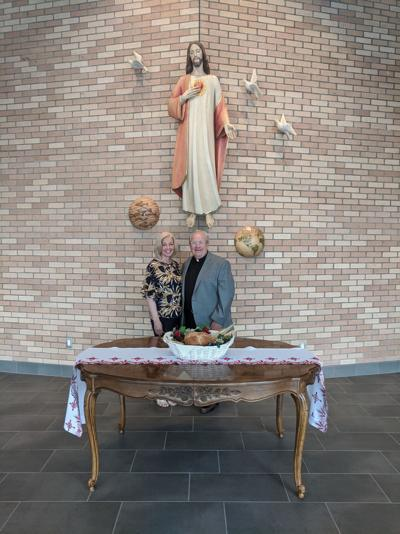 Pastoral Associate Gayle Castellani and the Rev. Andrew Kurovsky stand in the church lobby.