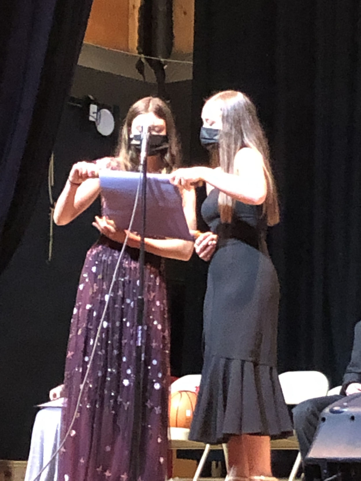 From left, Deana Mancuso and Taylor Mazza read the Class Will to their classmates.