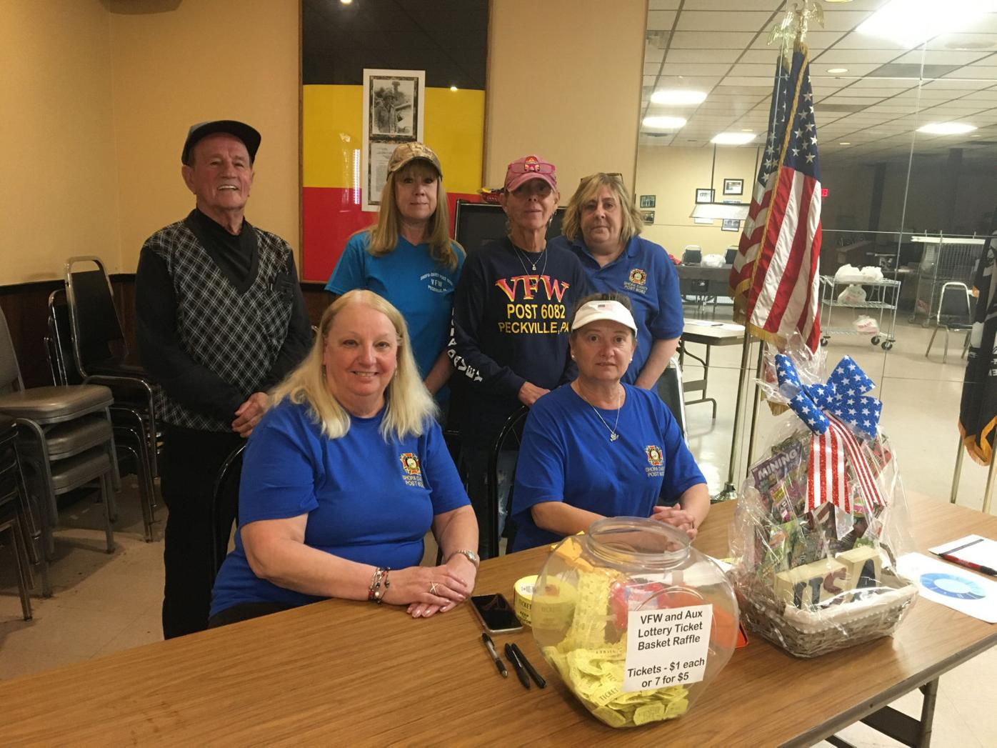The Lottery event also featured a lottery ticket basket raffle to benefit VFW Post 6082. Seated from left, Janet Sienkiewicz and Leslie Grunza, president of the Auxiliary. Standing from left, Steve Grassentti, Carman Caliber, Debbie, Litcho and Mary Merryfield.