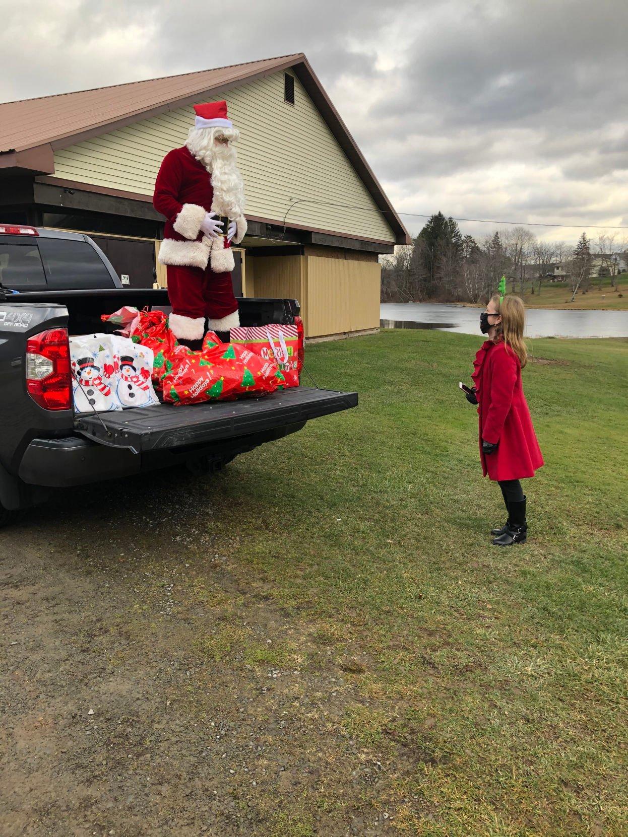 Santa visits with twirler Vanessa Van Deusen from Carbondale