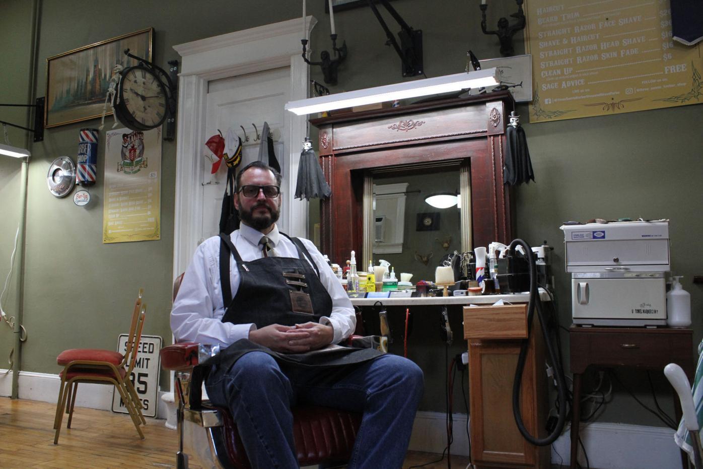 Three Saints Barber Shop & Shave Parlor owner Mike McAndrew