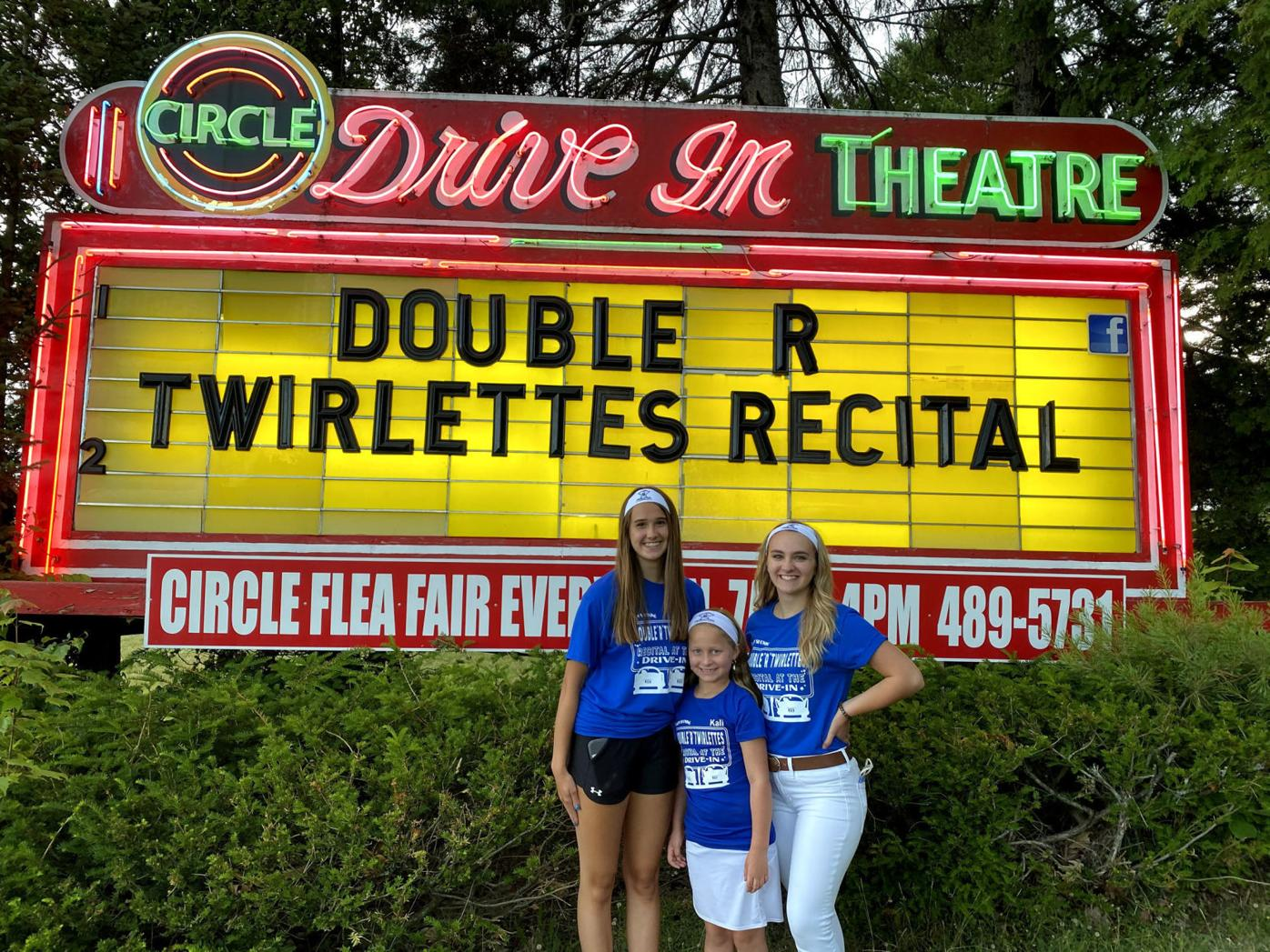 Group members from left Jordan Gioupis, Kali Mercatili, Allie Taffera stand next to the Circle Drive-In's marquee.