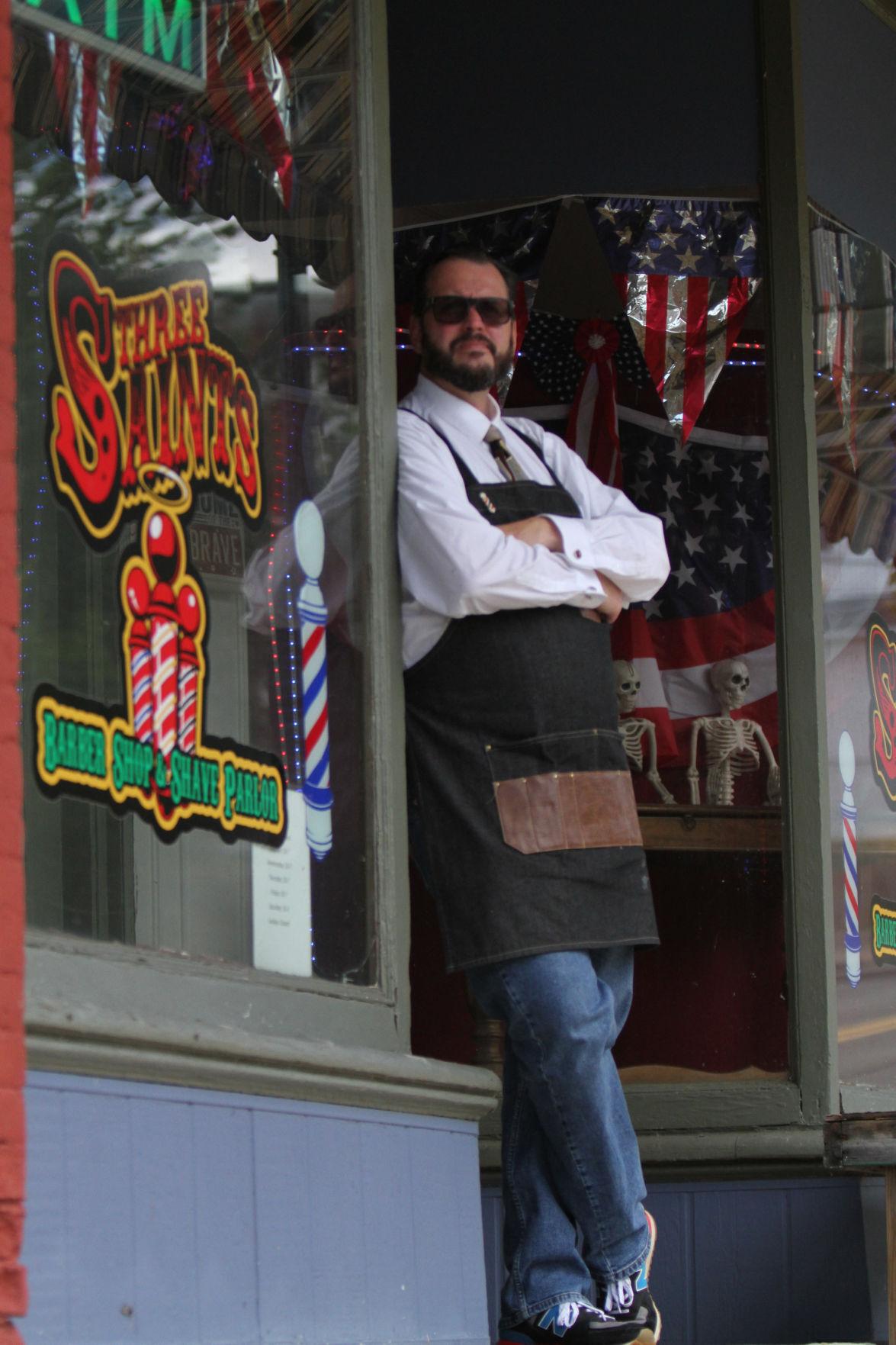Three Saints Barber Shop & Shave Parlor owner Mike McAndrew.