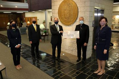 Shown at the AllOne Charities check presentation to Catholic schools are, from left: Kristen