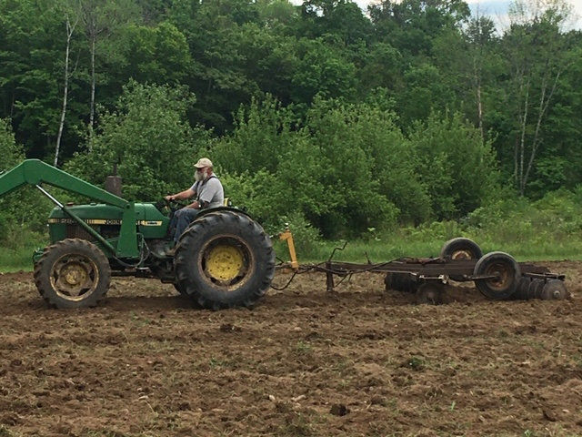 Steve Duda, Brookvalley Farms in Carbondale, drives a tractor on Mountain Sky's land.
