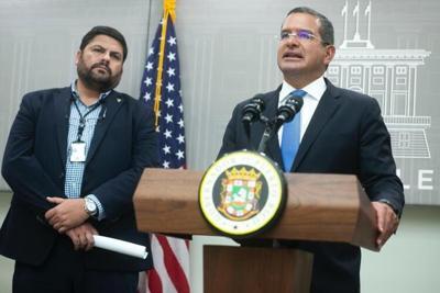 Health Secretary Carlos Mellado and Gov. Pedro Pierluisi