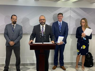 Manuel Laboy, DDEC secretary (center), and Brian C. Moyer, director of BEA