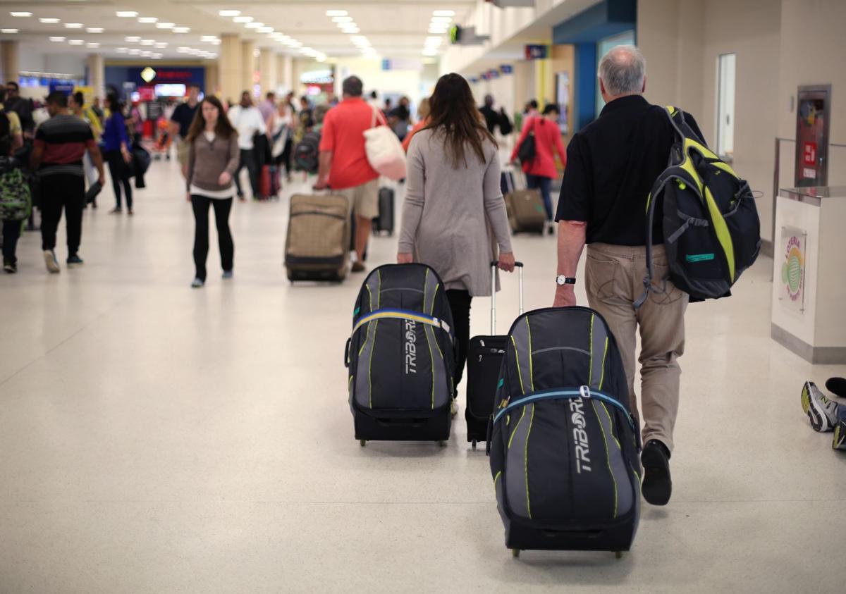 Passengers leaving Luis Muñoz Marín Airport