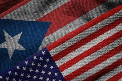 Flags of USA and Puerto Rico on Grunge Texture