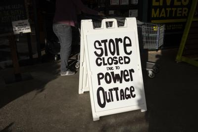 Store Closed Due to Power Outage (sign)