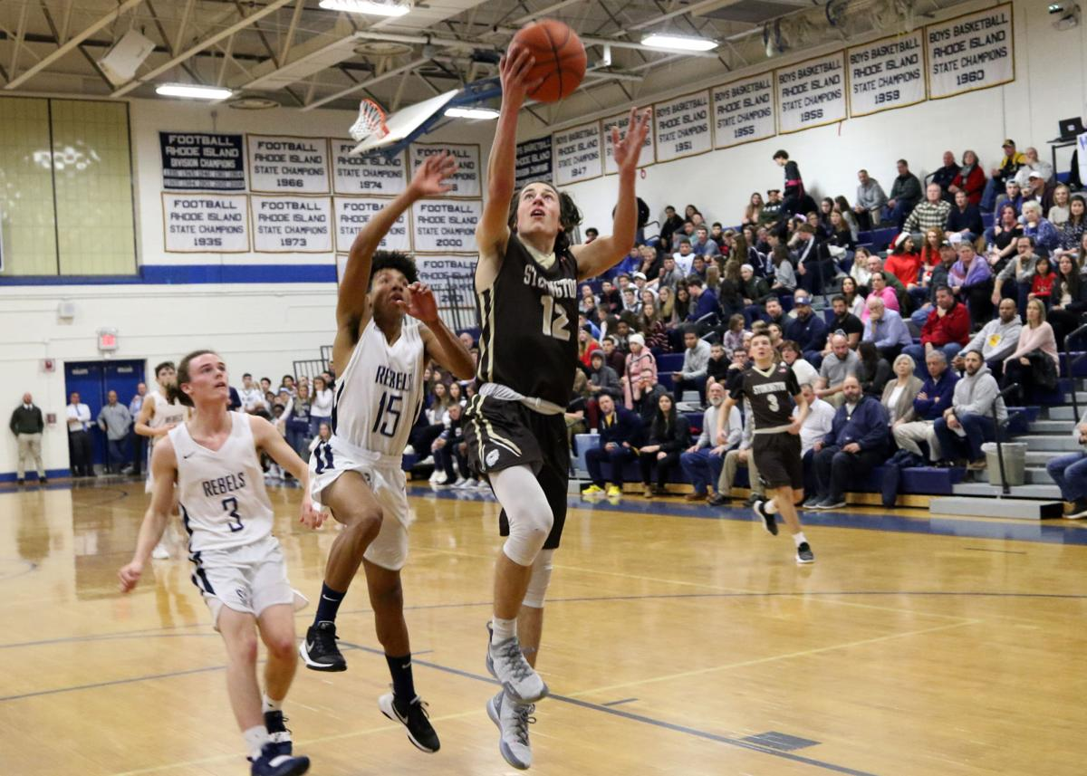 Stonington's RJ Parrilla (12) rises to the basket against South Kingstown in the 35th Annual WCCU Holiday Basketball Tournament Wednesday evening, December 26th, 2018 at Westerly High School. | Jackie L. Turner, Special to The Sun.