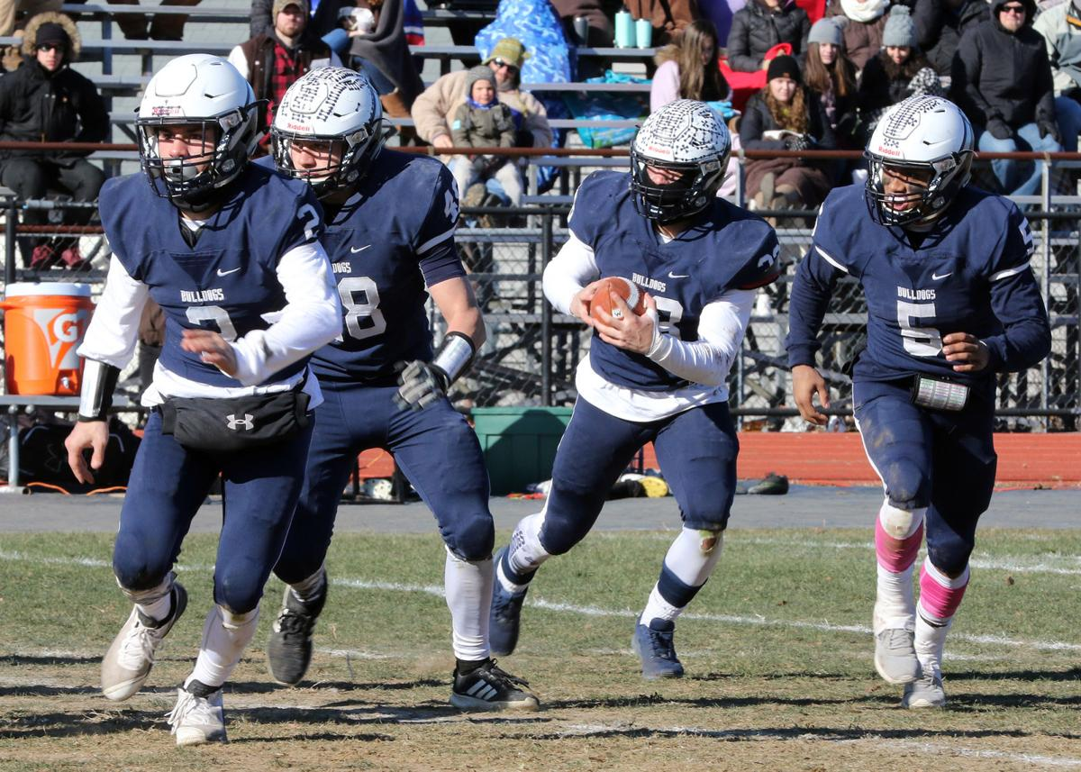 Westerly teammates Jon Brutcher (2), Josh Lacerte (48), and Jalen Valentin (5) clear a path for Tristan Turano (33) as he carries the ball up field during the 100th Annual Westerly vs Stonington Thanksgiving Day football game, held November 22nd, 2018 at Westerly's High School's Augeri Field. | Jackie L. Turner, Special to The Sun.