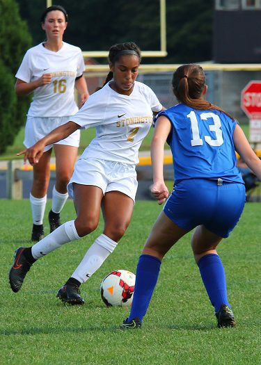 Stonington sophomore midfielder Venessa Benjamin dribbles the ball against a Putnam opponent in the varsity soccer match played Tuesday, September 11th, 2018 at Stonington High School.   Jackie L. Turner, Special to The Sun.