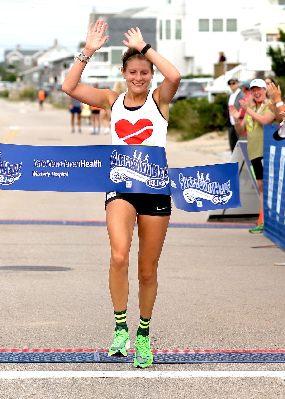 Amy Tortorello, 28, of Brookline, Massachusetts, was the first female runner across the line in 1:20:52, good for 13th overall. | Jackie L. Turner, Special to The Sun