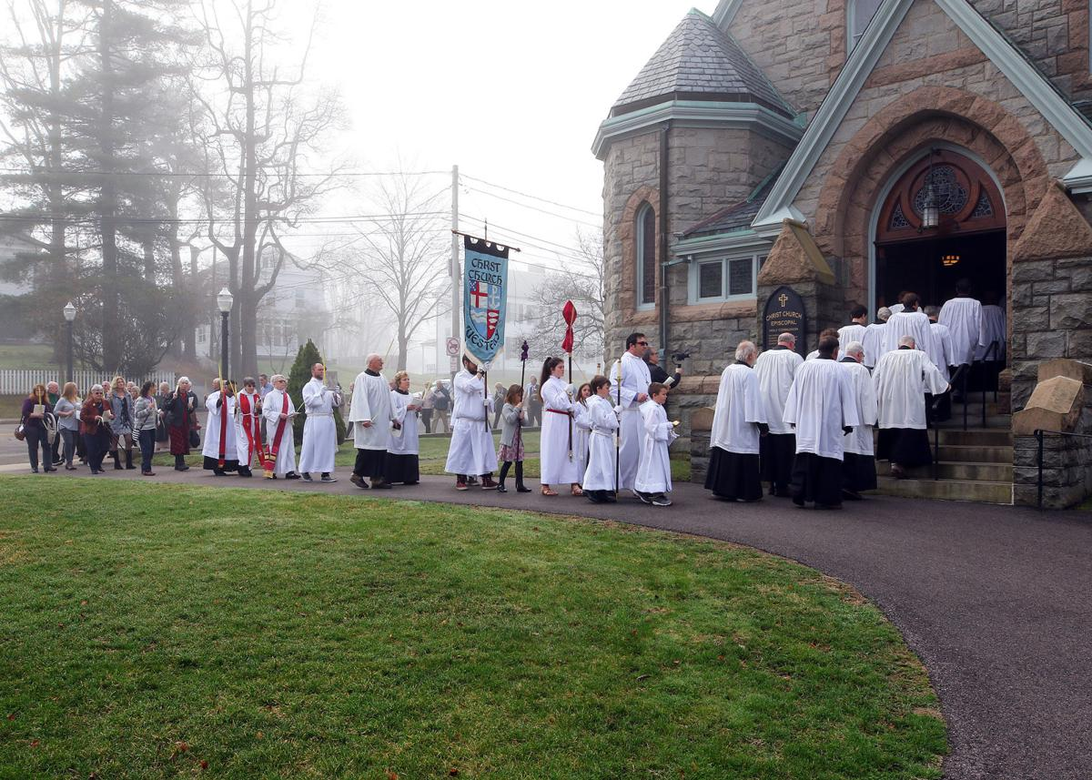 Acolytes, Clergy, and Choir members of Westerly's Christ Church lead the congregation into their place of worship on a cool and foggy April 14th, 2019 Palm Sunday morning. | Jackie Turner, Special to The Sun.