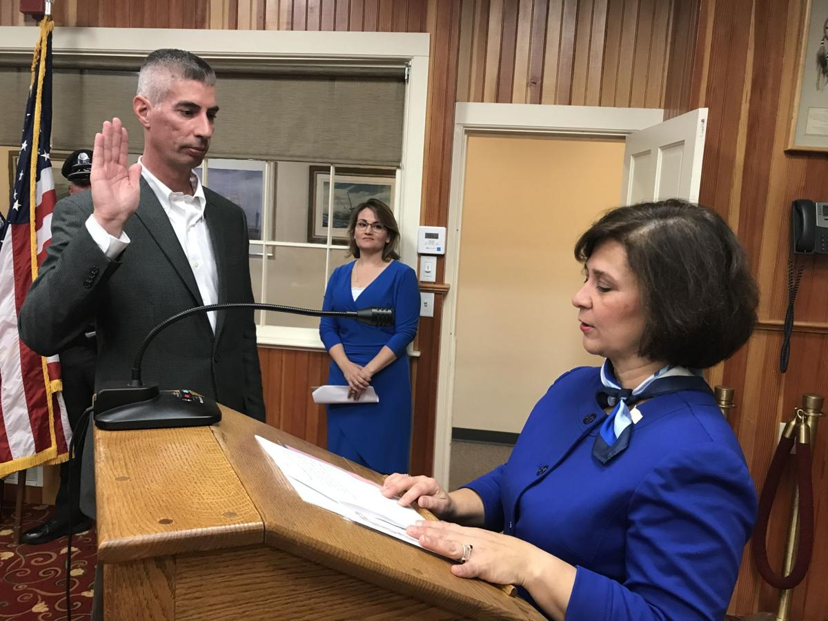 R.I. Secretary of State Nellie Gorbea, right, administered the oath of office to newly- elected Charlestown Town Council member, David Wilkinson. The ceremony took place Monday at the Town Hall. Cynthia Drummond, The Westerly Sun