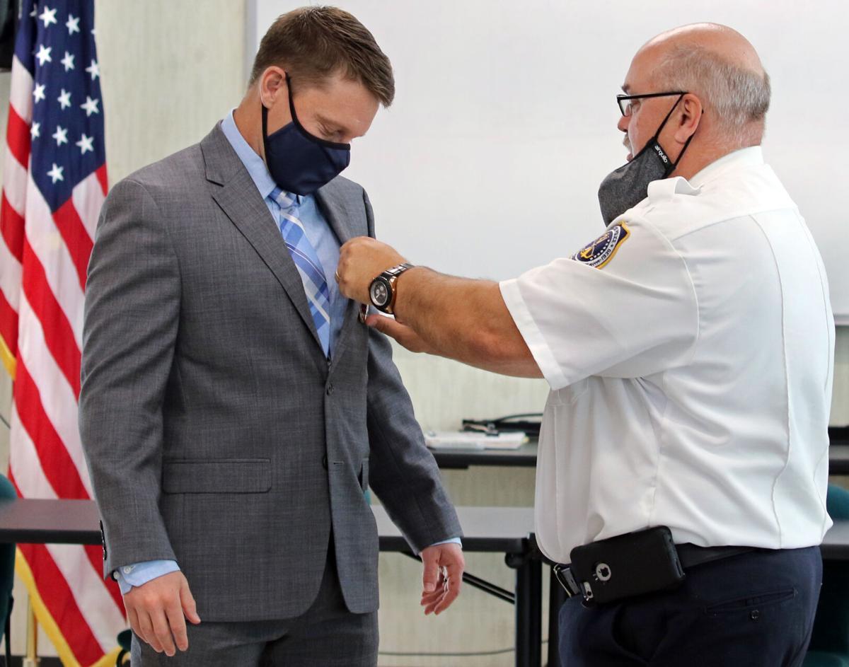 090721 STN New SPD Kyle Miller sworn in hh 78103.JPG
