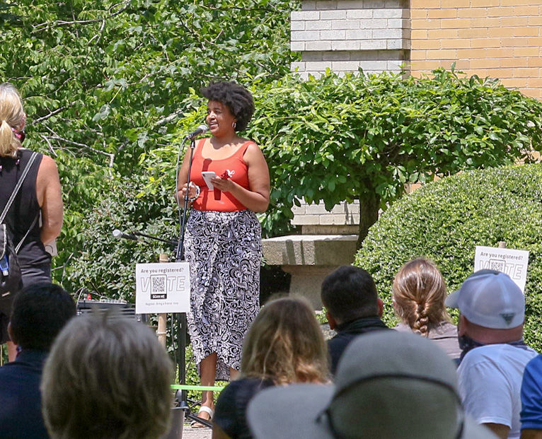 Groton Middle School science teacher Erica Watson addresses a large crown gathered on the steps of the Stonington Free Library Sunday, June 5th, 2020, for a BLM rally sponsored by the Stonington Democrats. Erica was one of a number of speakers on hand for the event. | Jackie Turner, Special to The Sun.