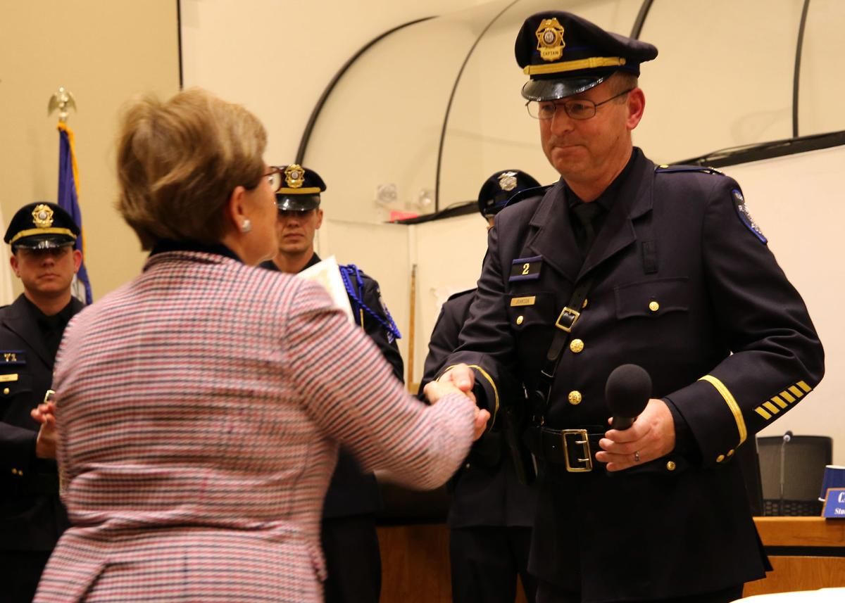 Westerly Town Clerk Donna Giordano congratulates Westerly Police Captain Steven R. Johnson (previously a Lieutenant) on his promotion after he is sworn into his new position in the police department. The event took place in the Town Council Chambers of the Westerly Town Hall on Monday evening, January 7, 2019. | Jackie L. Turner, Special to The Sun.