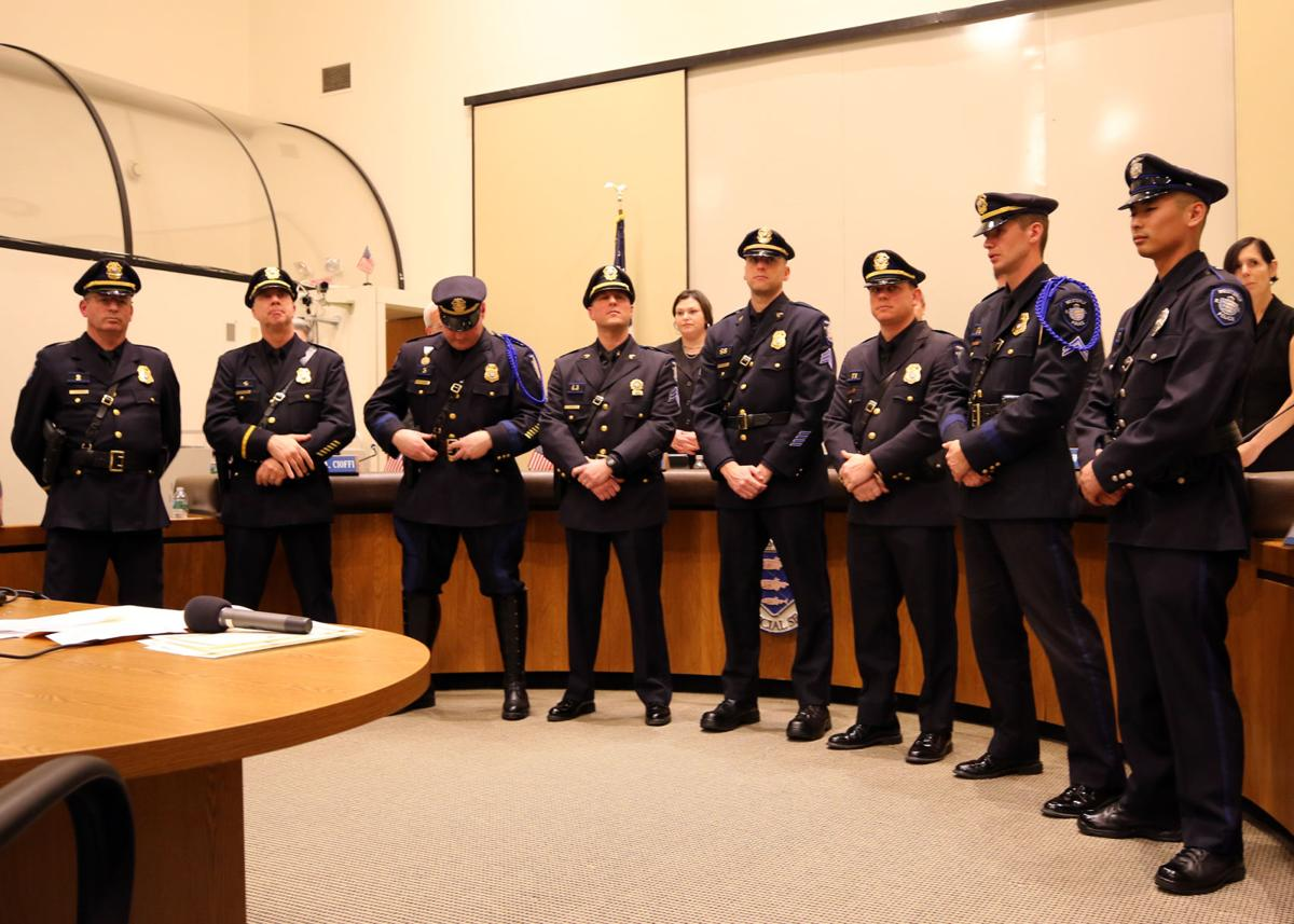 Eight officers of the Westerly police department stand ready to receive their promotion and swearing in of their new positions within the force. From left to right: Lieutenant Steven R. Johnson - promoted to Captain, Sergeant Wayne, J. Crockford - promoted to Lieutenant, Sergeant James P. Campbell - promoted to Lieutenant, Detective John A. Riley, Jr. - promoted to Detective Sergeant, Corporal Shawn D. Rathgaber - promoted to Sergeant, Investigator Ryan M. Page - promoted to Detective, Patrolman Marshall E. Johnson - promoted to Corporal, and Recruit Andrew P. Iacoi - promoted to Patrolman. The event was held in the Counsel Chambers of the Westerly town hall on Monday evening, January 7th, 2019. | Jackie L. Turner, Special to the Sun.