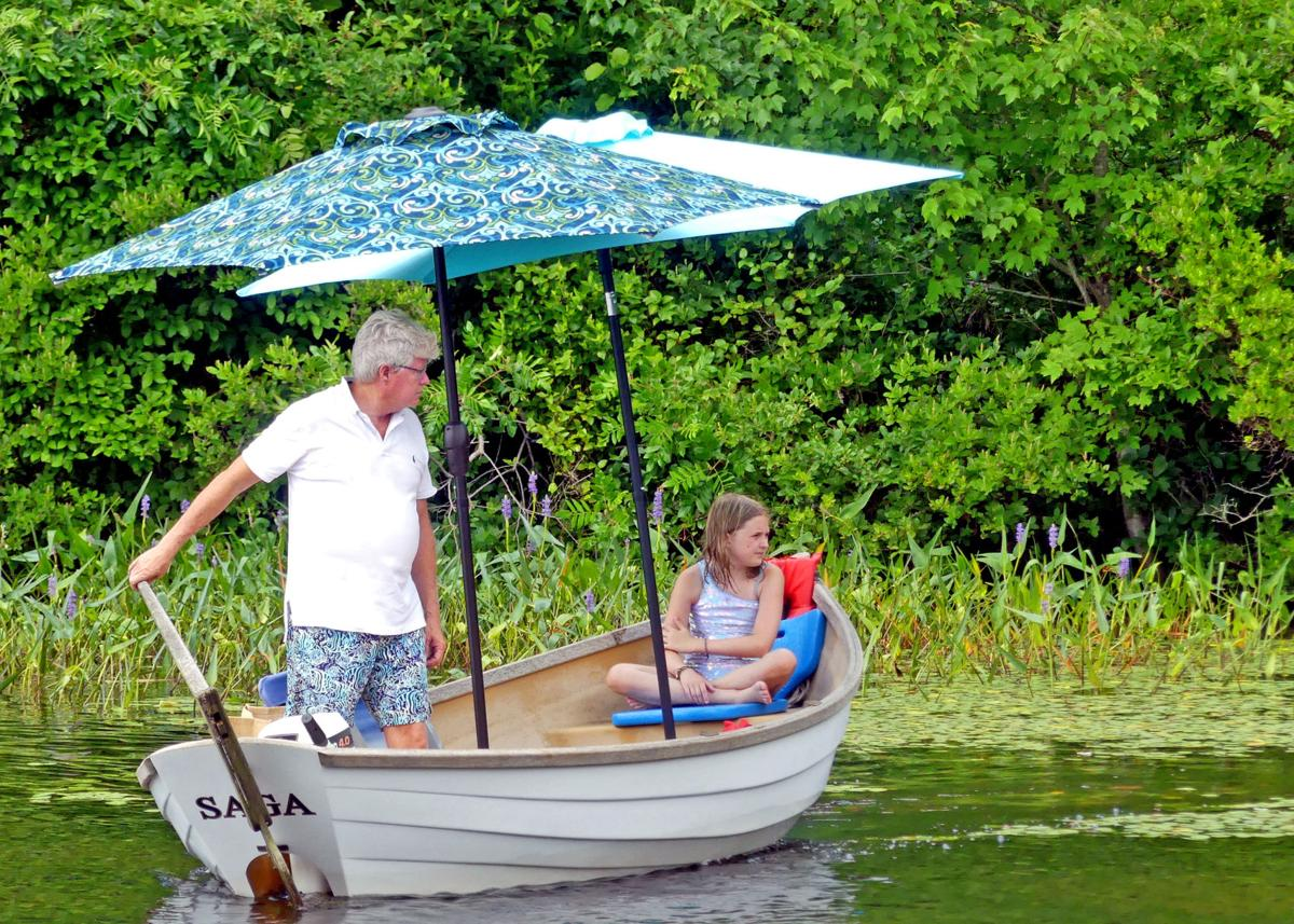 NSTN Dory with umbrellas on lake 26287.JPG
