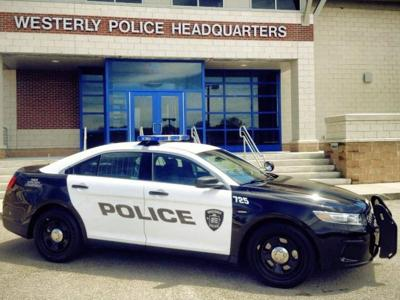 standing Westerly Police Department Cruiser