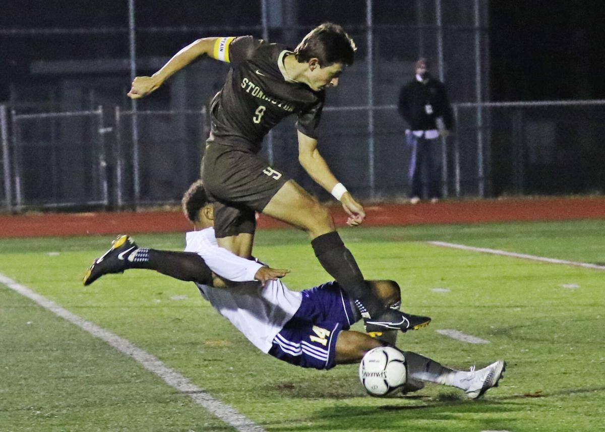 Stonington's Samuel Montalto (9) gets tangled up with Ledyard's Nicholas Washington (9) as he drives the ball up-field during the Stonington Bears vs Ledyard Colonels boys varsity soccer game played Friday evening, November 6, 2020 at Stonington High School's Palmer Field. | Jackie L. Turner, Special to The Sun.