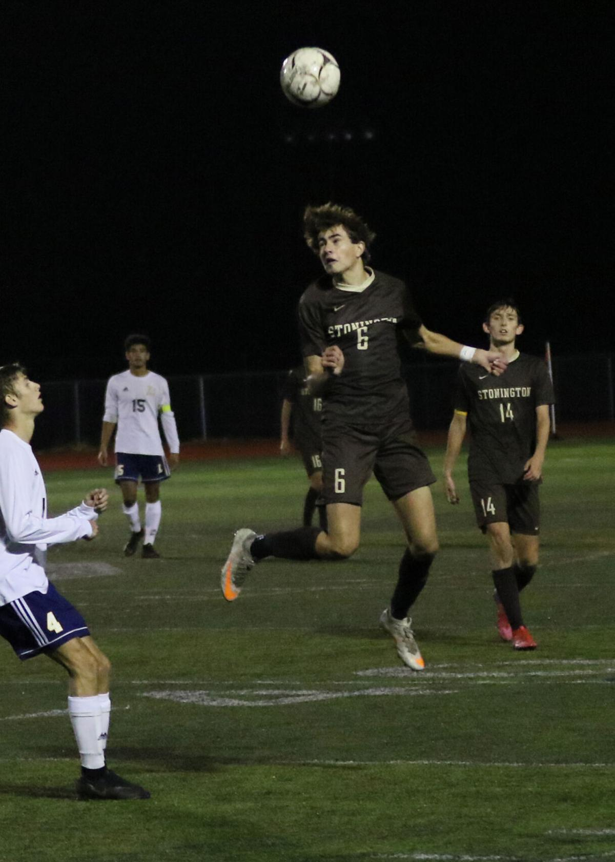 William Swain (6) deflects the ball for the Bears as teammate William deCastro (14) looks on. The Stonington Bears boys' varsity soccer team played the Ledyard Colonels Friday evening, November 6, 2020, at Stonington High School's Palmer Field. | Jackie L. Turner, Special to The Sun.