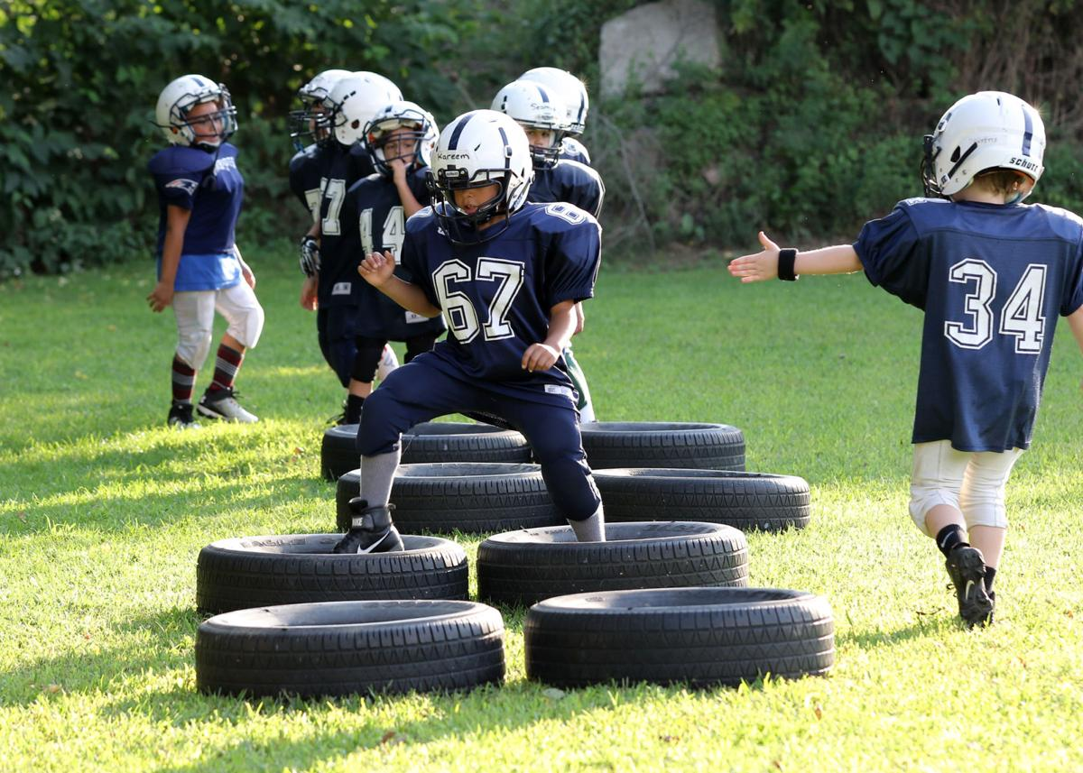 Westerly Youth Football players in the nine to ten year-old (10U) division sprint through a tire run during practice on Thursday evening, August 22nd, 2019 at the Westerly Youth Football Field on Old Hopkinton Road in Westerly. Tire runs are an indispensible training tool as it helps to build leg strength, speed, and agility. Jackie L. Turner, Special to The Sun.