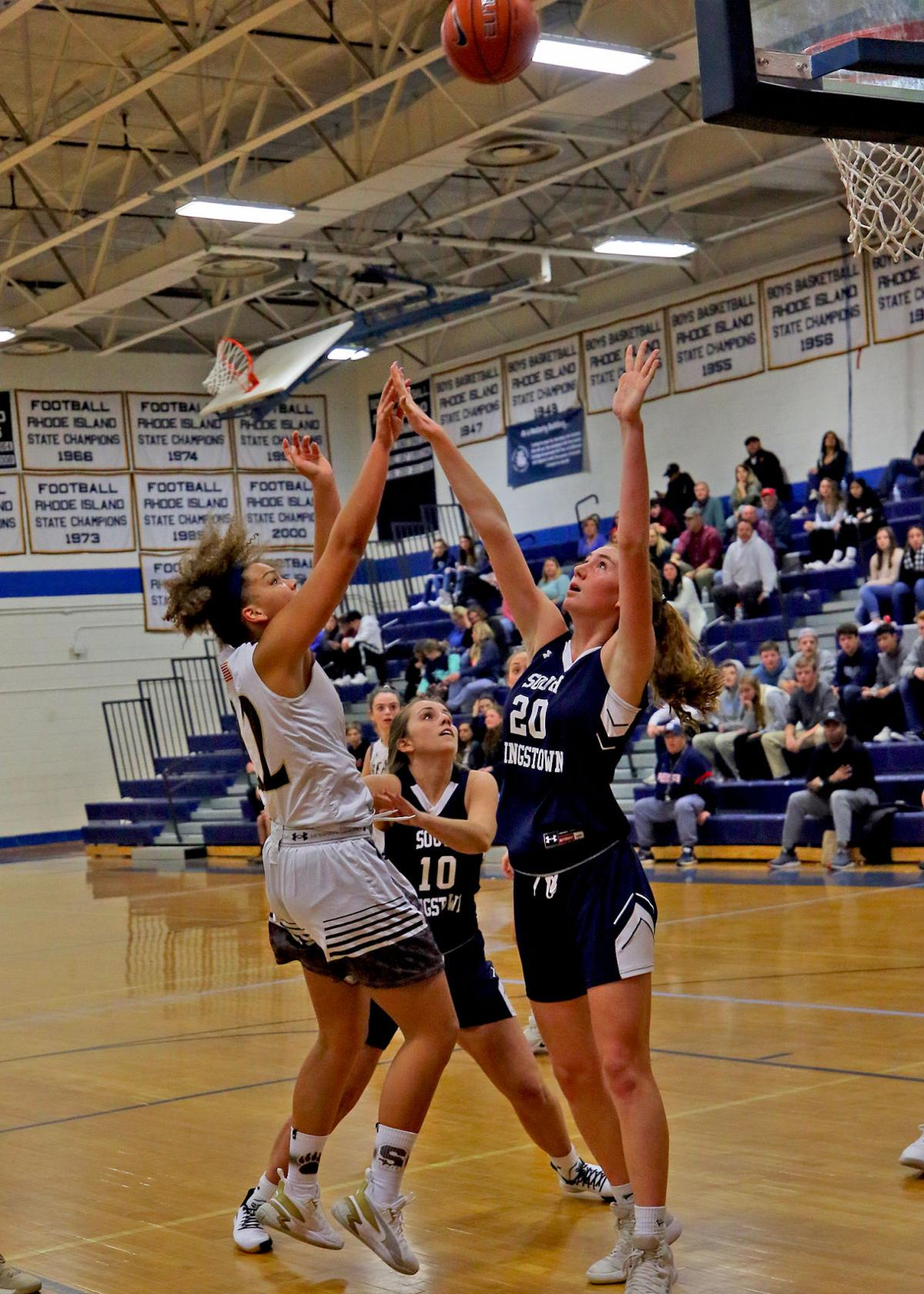 Stonington's Sophia Bell (22) shoots over the head of South Kingstown's Carly Fewlass (20) in the Stonington Bears vs South Kingstown Rebels girls varsity WCCU Holiday Basketball Tournament Championship Game played Saturday evening, December 28, 2019 at Westerly High School. | Jackie L. Turner, Special to The Sun.