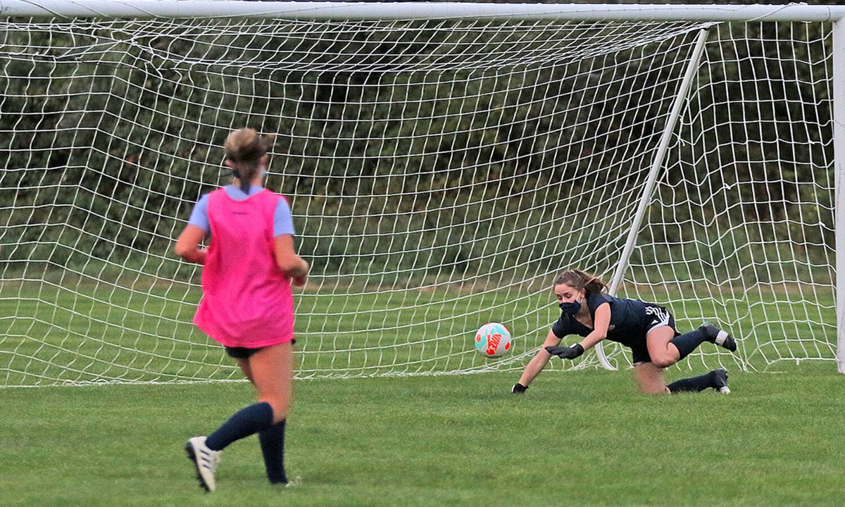 Westerly Bulldogs girls soccer team senior goalie Mackenzie Fusaro dives at a shot-on-net during a practice scrimmage game held Tuesday evening, September 15, 2020, at Gingerella Sports Complex in Westerly. | Jackie L. Turner, Special to The Sun.