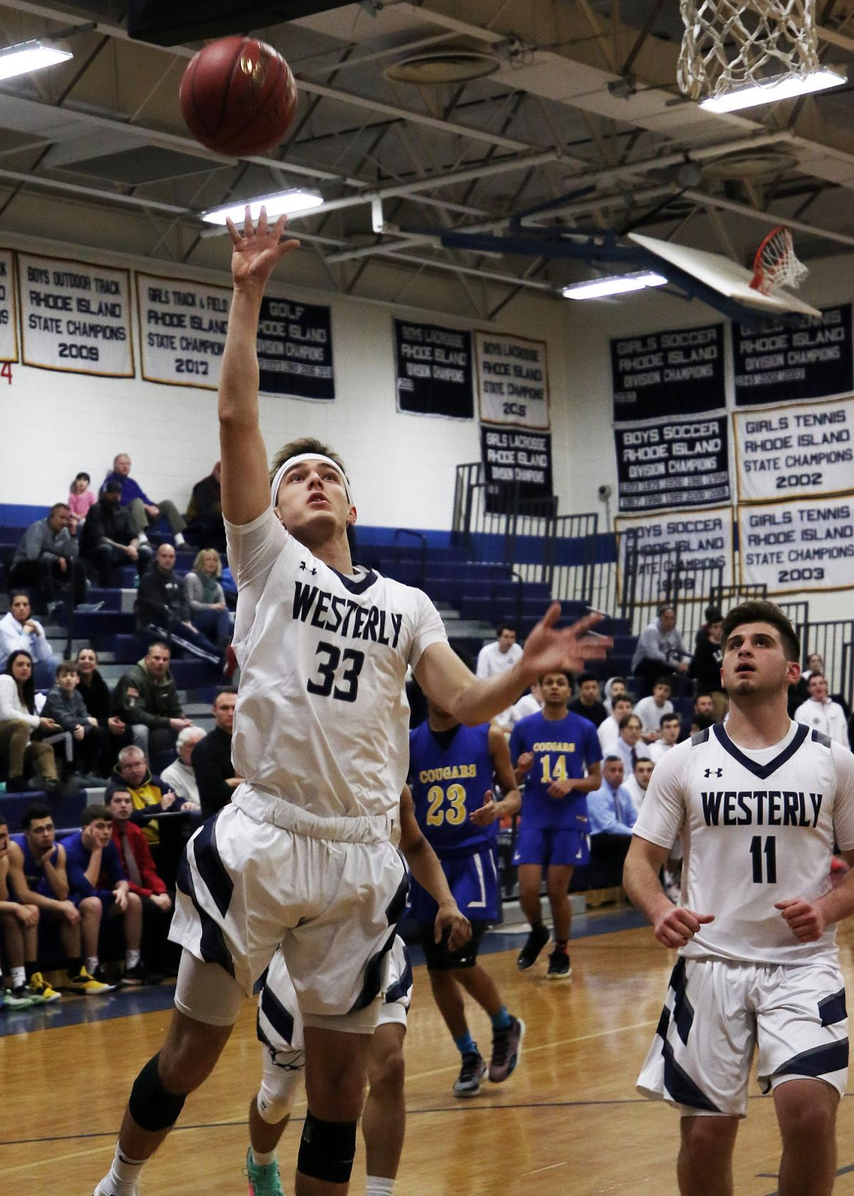 Chas Morgan (33) lays one up for Westerly while teammate Cole Riley (11) looks on in the Westerly vs N. Providence boys' varsity basketball game played Tuesday evening, February 19th, 2019, at Westerly High School. | Jackie L. Turner, Special to The Sun.