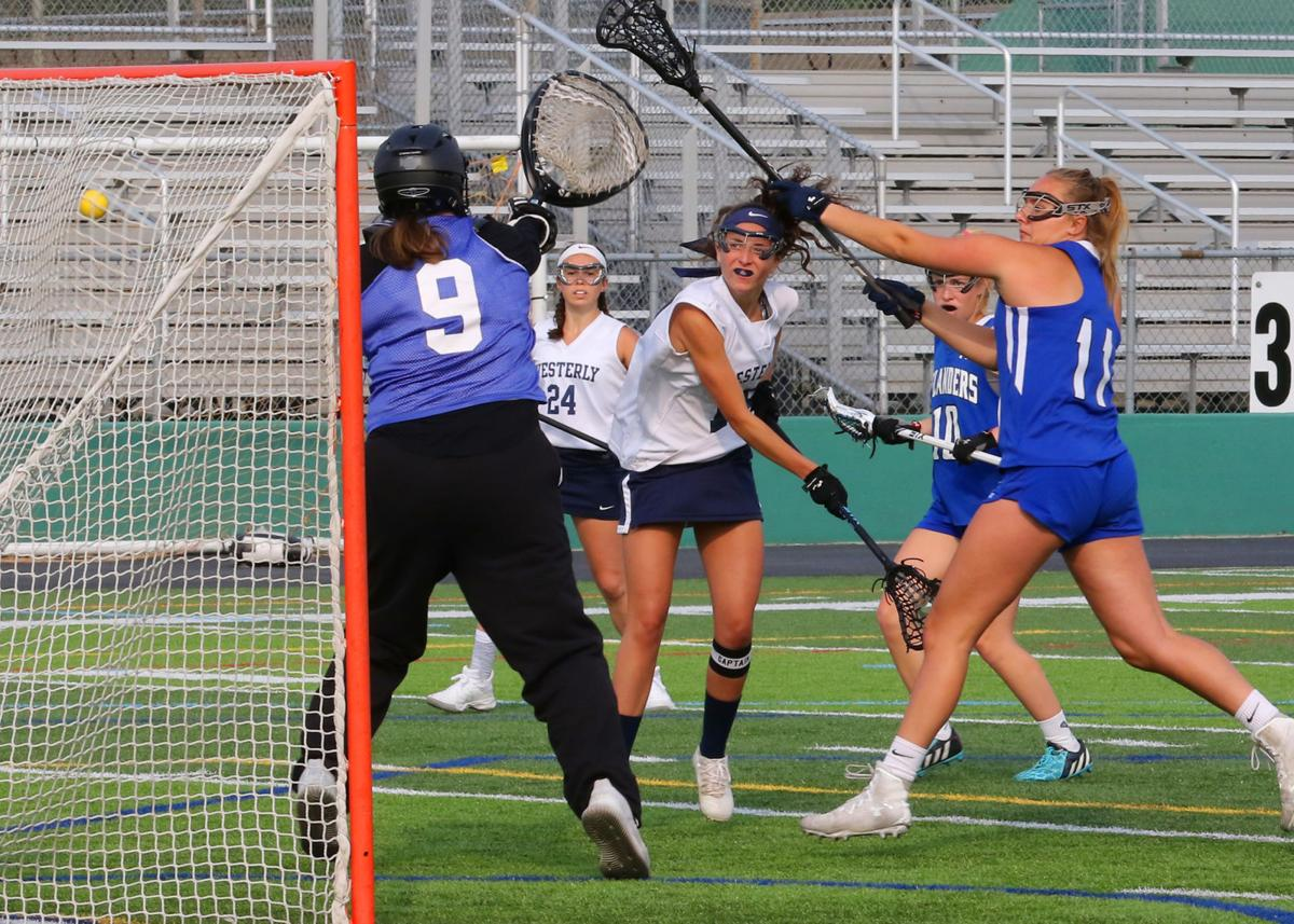 Ashley Amato (19) takes a shot against Middletown goalie Virginia Murphy (9) and scores while her Westerly teammate Grace Armstrong (24) looks on. The Westerly Bulldogs girls' varsity lacrosse team played the Middletown Islanders in the Rhode Island Interscholastic League Division-II final on Saturday, June 1st, 2019, at Cranston Stadium in Cranston, RI. | Jackie L. Turner, Special to The Sun.