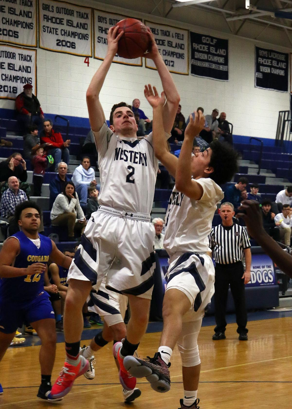 Westerly's Connor Warner (2) grabs a rebound with teammate Byron Dunn (3) while Noah Warren (12) looks on for North Providence. The Westerly Bulldogs boys varsity basketball team hosted the North Providence Cougars on Tuesday evening, February 19th, 2019 at Westerly High School's Federico Gymnasium. | Jackie L. Turner, Special to The Sun.