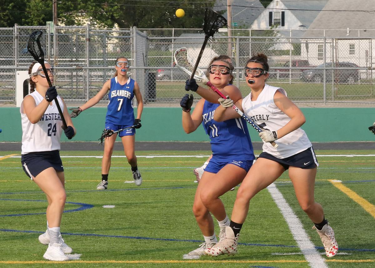 Carly Chretien (5) contends for a loose ball against Middletown's Katherine Canby (11) while Westerly teammate Grace Armstrong looks on. The Westerly Bulldogs girls' varsity lacrosse team played the Middletown Islanders in the Rhode Island Interscholastic League Division-II final on Saturday, June 1st, 2019, at Cranston Stadium in Cranston, RI. | Jackie L. Turner, Special to The Sun.