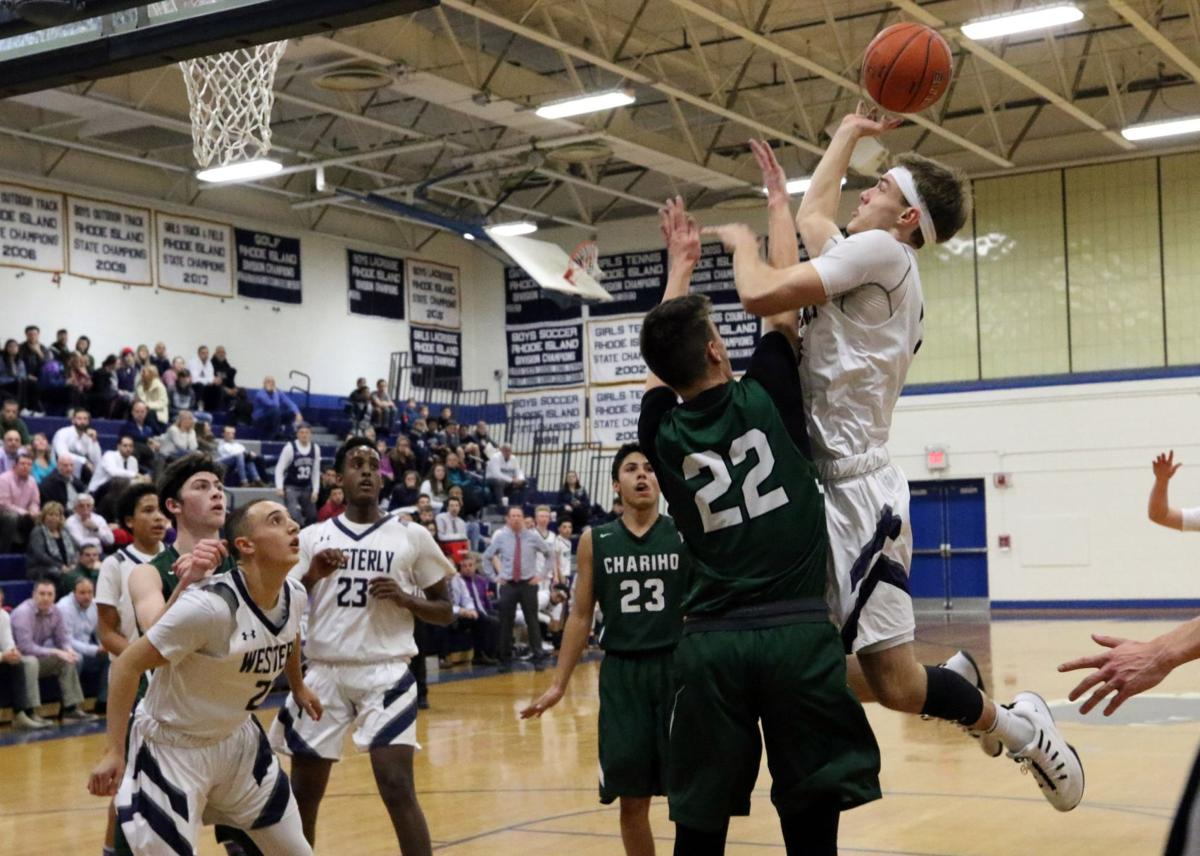 Bulldog Chas Morgan (33) goes to the basket against Chariho's