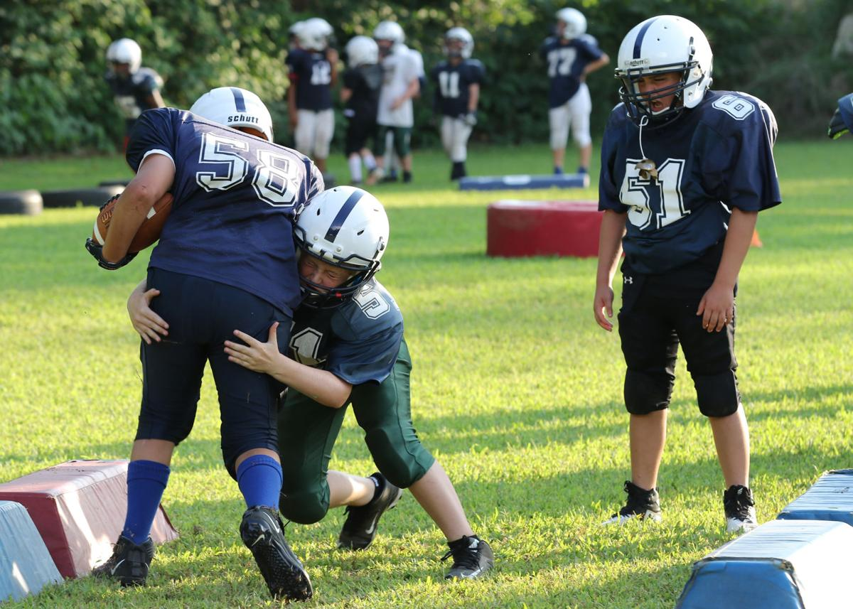Westerly Youth football 12U players run through tackling drills during practice on Thursday evening, August 22nd, 2019, at the Westerly Youth Football Field on Old Hopkinton Road in Westerly. | Jackie L. Turner, Special to The Sun