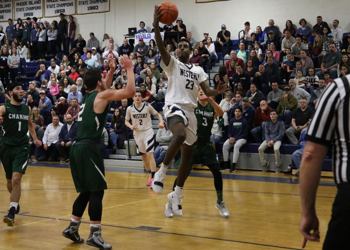 Westerly's Bereket Janet (23) lays up against Chariho in the 35th Annual WCCU Holiday Basketball Tournament played Wednesday evening, December 26th, 2018 at Westerly High School. | Jackie L. Turner, Special to The Sun.
