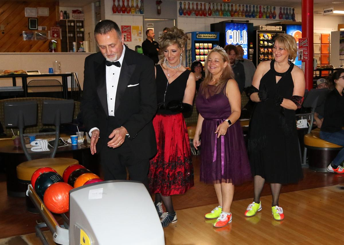 "Saturday evening, January 25th, 2020, at the Alley Katz Bowling Center in Westerly was an evening of ballroom style bowling as more than a dozen teams competed in the Jonnycake Center of Westerly's ""Ballroom Bowling Bash"" fundraiser. Most certainly one of the best-dressed teams was that from event sponsor Jewett City Savings Bank. From left: John Couillard, Shannon Haeseler, Dianne Chiavarini, and Amy Panciera. 