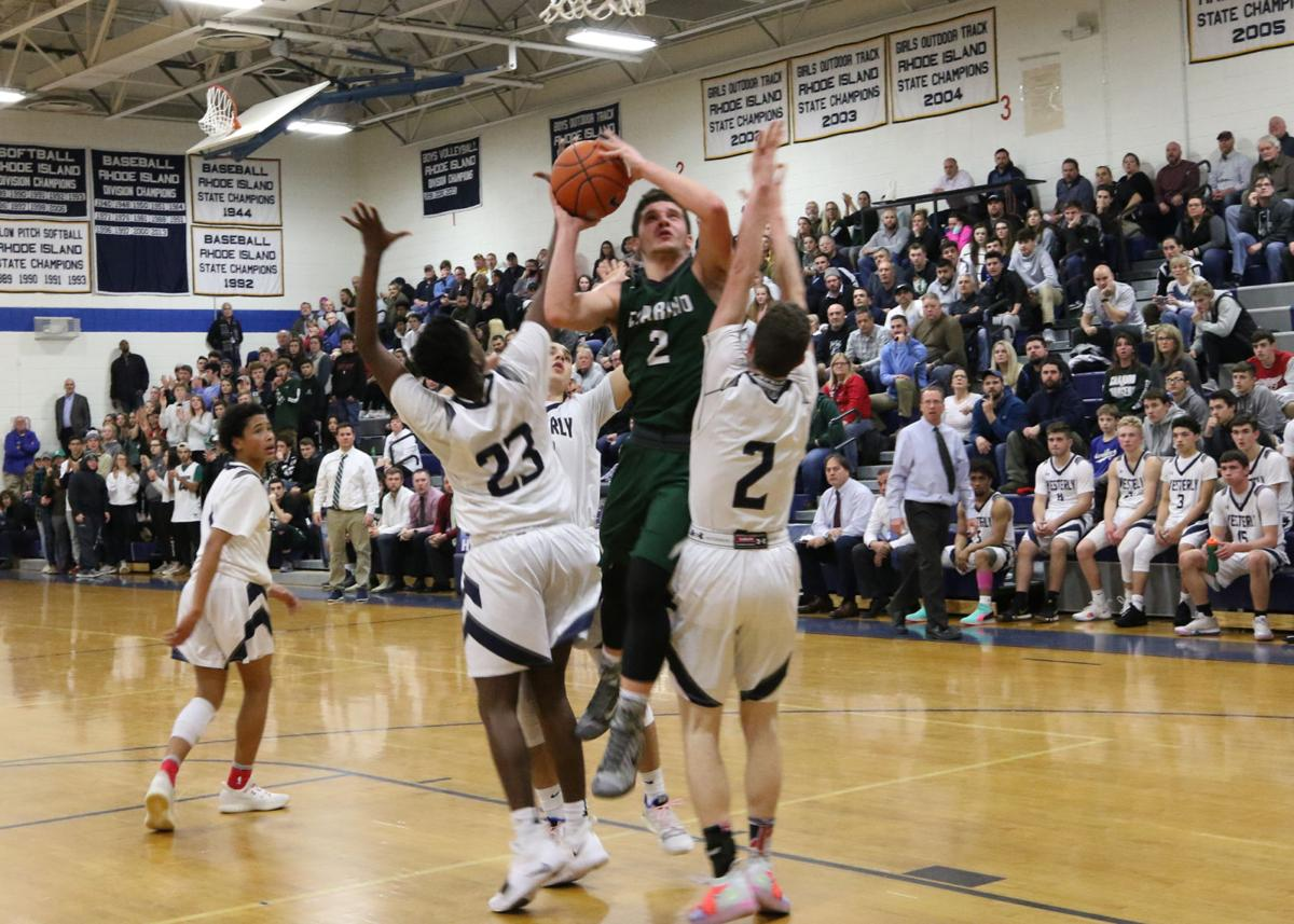 Chariho's Luke Fusaro (2) rises to the basket against Westerly in 35th Annual WCCU Holiday Basketball Tournament played Wednesday evening, December 26th, 2018 at Westerly High School. | Jackie L. Turner, Special to The Sun.