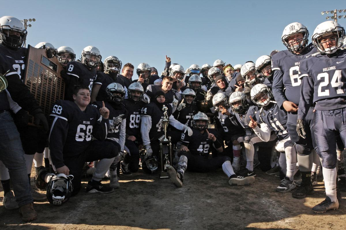 The Westerly Bulldogs have a lot to be happy about as they shut-out the Stonington Bears 61 to 0 to win the 100th Annual Westerly vs Stonington Thanksgiving Day football game, held November 22nd, 2018 at Westerly's High School's Augeri Field.   Jackie L. Turner, Special to The Sun.