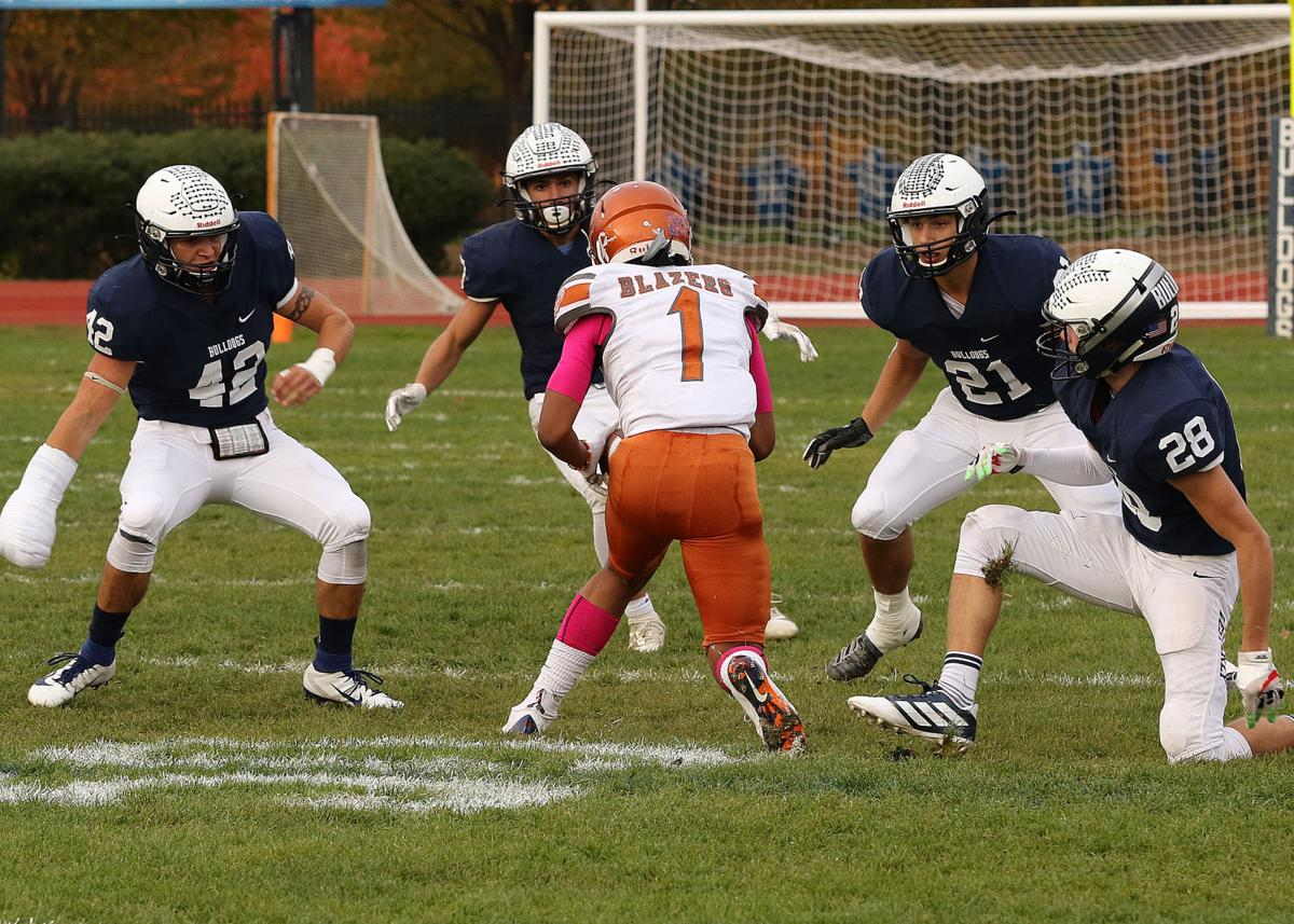 A wall of Westerly Bulldog players makes sure Capital Prep's Julian Ferguson has nowhere to run way in the Westerly Bulldogs vs Hartford Capital Prep Trailblazers boys varsity football game played Friday afternoon, October 25th, 2019, at Westerly High School's Augeri Athletic Field, Westerly, RI. From left are Westerly players Derek Mason (42), Rocco Cillino (7), Tyler Rodriguez (21) and Joe Fusaro (28). | Jackie L. Turner, Special to The Sun.